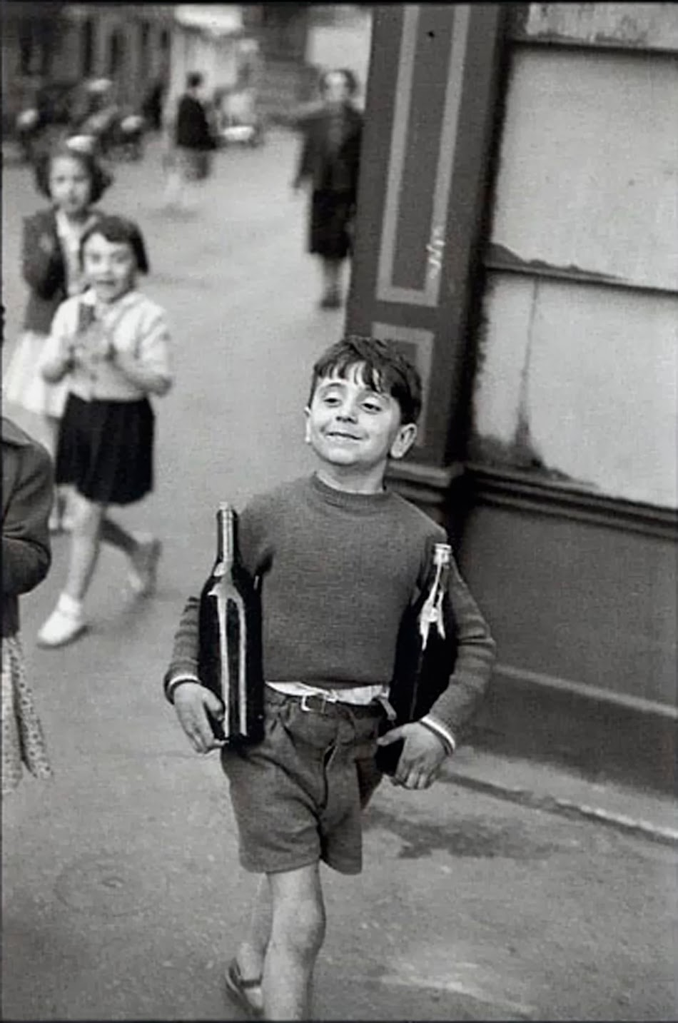 cartier-bresson-child-carrying-wine-proud